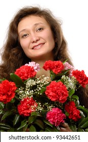 Young smiling woman with a bunch of red carnations in her hands