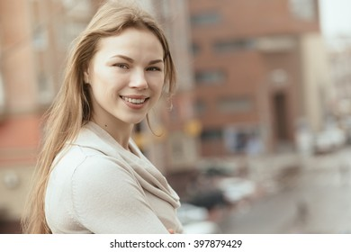 Young smiling woman in city