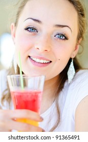 Young smiling woman drink cocktail