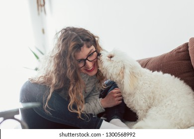 Young smiling woman enjoying with her dog