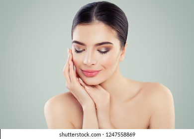 Young smiling woman. Facial treatment, skincare and spa concept