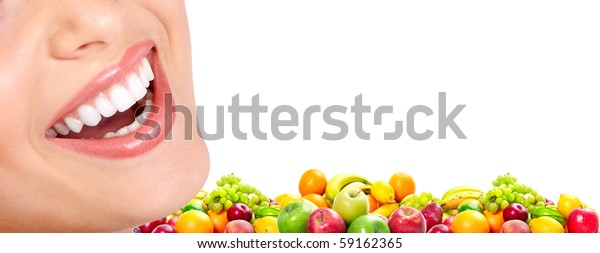 Young smiling woman  with fruits. Over white background