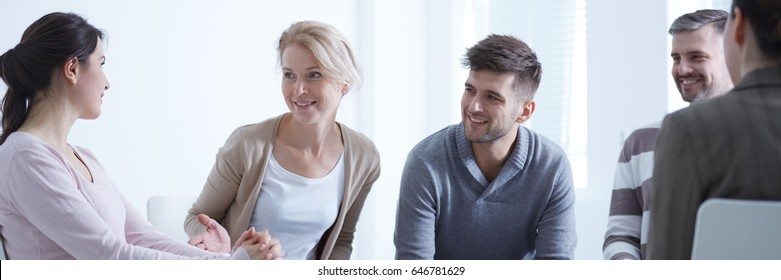 Young smiling woman getting support on psychotherapy session