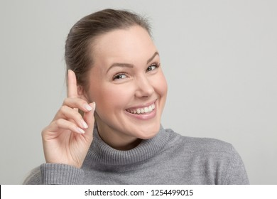 Young smiling woman has an idea