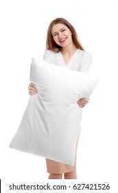 Young smiling woman holding orthopedic pillow on light background. Healthy posture concept
