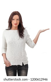 Young smiling woman holding out her hand as if she were displaying something.You can add any text or object on the palm of her hand.