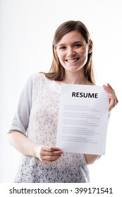 young smiling woman holding a resume that could be yours or hers but it is blurred in his body text