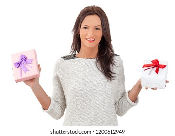 Young smiling woman holding two gift boxes, isolated against a white background.