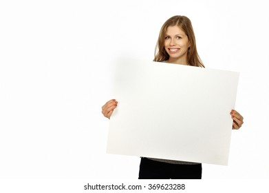 Young smiling woman holding white empty paper isolated on white background. Place for your slogan.