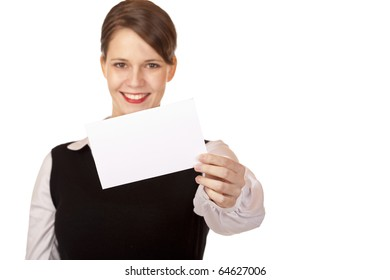 Young smiling woman holds business card in camera. Isolated on white background.