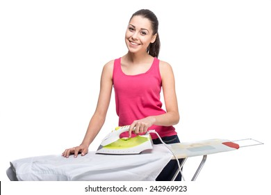 Young smiling woman is ironing a shirt with a steam iron on white background.