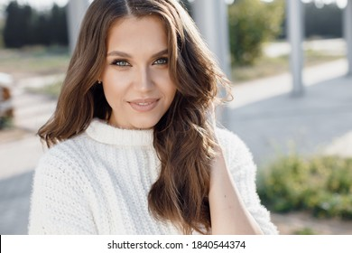 Young smiling woman outdoors portrait, happy face