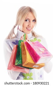 Young smiling woman with shopping bags over white background