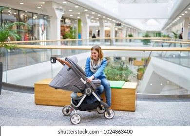 Young smiling woman speaking with her baby