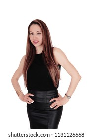 A young smiling woman standing halve length in a black blouse