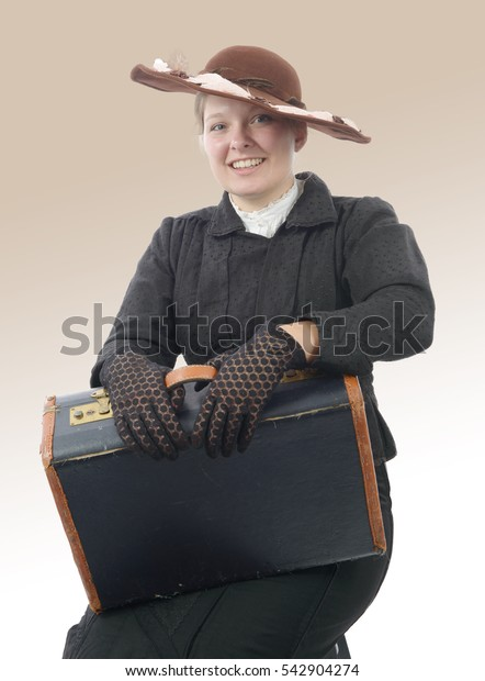 young smiling woman in vintage costume 1900s with suitcase