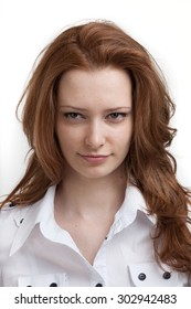 Young smiling woman in white blouse, portrait