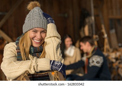 Young smiling woman in winter clothes cottage enjoy holiday friends
