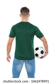 Young soccer fan back with green shirt and ball in hands on white background