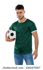 Young soccer fan with green shirt ball in hands on white background