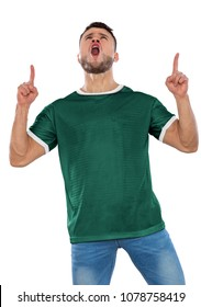 Young soccer fan with green shirt screaming with emotion on white background