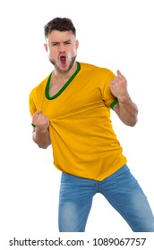 Young soccer fan with yellow and green shirt screaming with emotion on white background