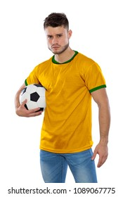 Young soccer fan with yellow and green shirt holding soccer ball on white background