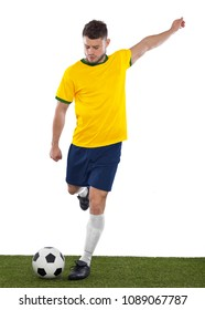 Young soccer fan with yellow and green shirt playin soccer with emotion on white background