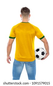 Young soccer fan with yellow and green  shirt ball in hands on white background