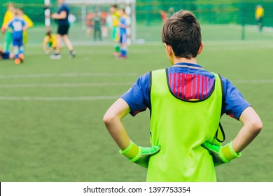 Young Soccer Goalie Goalkeeper. Young Boy Soccer Goalie. Sport activities for children. Football Match in the Backround.