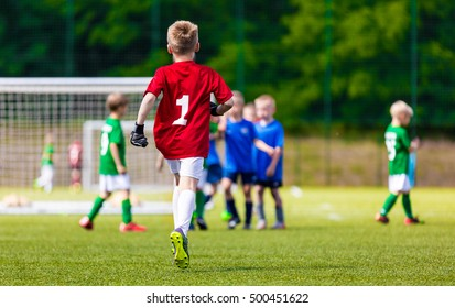 Young Soccer Goalie Goalkeeper. Young Boy Soccer Goalie. Youth Sports Soccer Football Background
