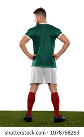 Young soccer player back on grass with green shirt  on white background
