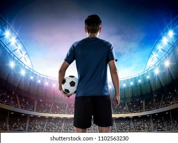 Young soccer player entering the stadium full