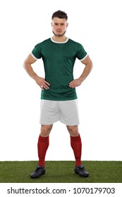 Young soccer player on grass with mexico green shirt on white background
