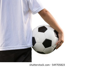 Young soccer playing, isolated on a white with copy space, holding a football.