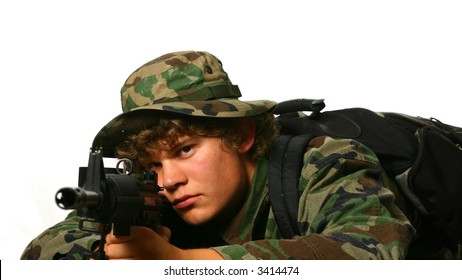 Young soldier with assault rifle in camoflague