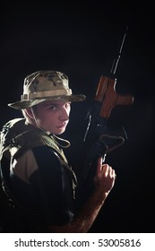Young soldier in camouflage with kalash rifle.