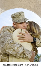 Young soldier embracing his woman outdoors