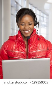 Young  South African woman on internet voice chat helping a customer.