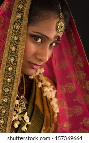 young south Indian woman in traditional sari dress