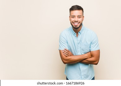 Young south-asian man laughing and having fun.