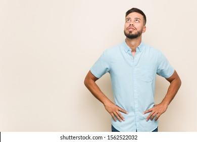 Young south-asian man tired of a repetitive task.
