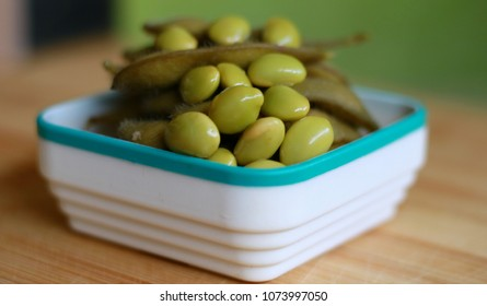 Young soy beans. Known as edamame with wood background.