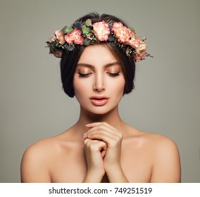 Young Spa Model Woman with Healthy Skin and Flowers. Spa Beauty and Skincare Concept