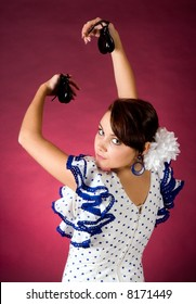 Young Spanish flamenco performer playing the castanets
