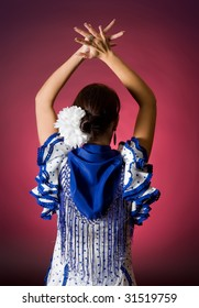 Young Spanish flamenco performer seen from her back