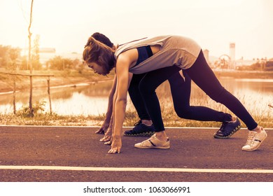 Young sport couple in starting position.