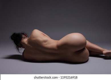 young sport naked girl on a dark background
