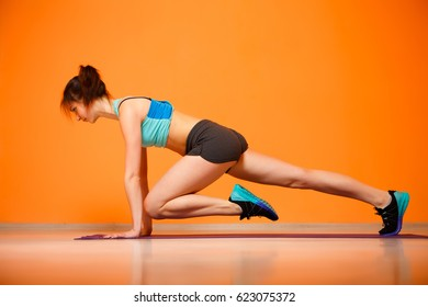 Young sport woman doing exercises