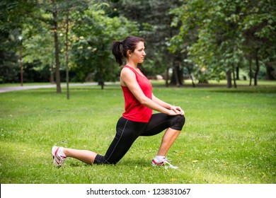 Young sport woman exercising before jogging - outside in nature